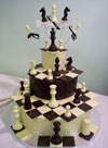 chocolate chess pieces on three chocolate tiers