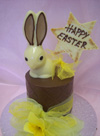 a picture of white chocolate Easter bunny on a milk chocolate tier