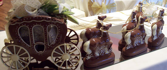 Hand-made milk and white chocolate wedding carriage and horses