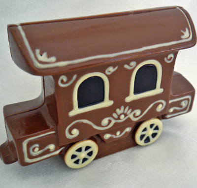 a picture of chocolate train carriage engine decorated with white, milk and dark, chocolate