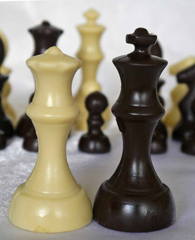 a picture of chocolate chess set decorated with white, and dark, chocolate