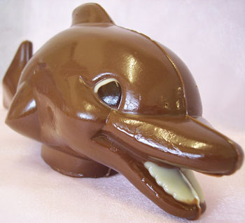 a picture of a milk chocolate dolphin decorated with white and dark chocolate