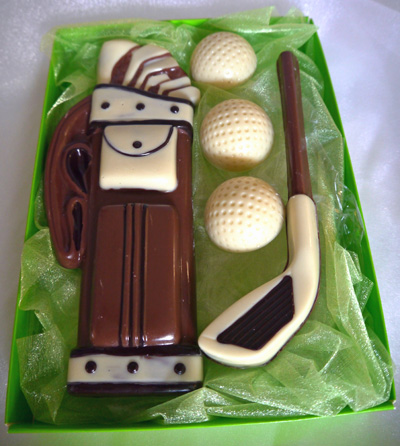 a picture of chocolate golf set decorated with white, dark, and milk chocolate