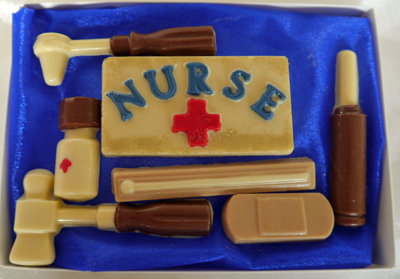 a picture of chocolate nurse set with white, dark, milk, and coloured chocolate