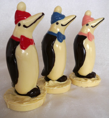 a picture of three white chocolate penguins