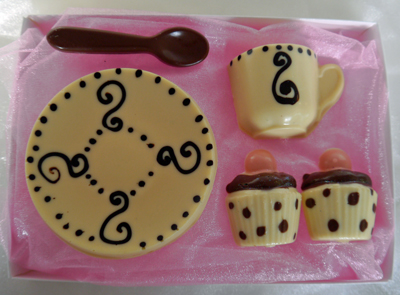 a picture of chocolate tea set with white, dark, milk chocolate, and cololured chocolate