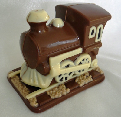 a picture of chocolate train engine decorated with white, milk and dark, chocolate