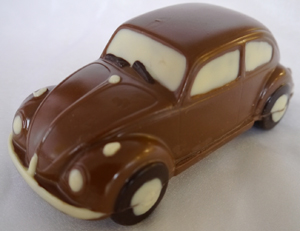 a picture of a milk chocolate VW beetle