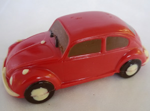 a picture of a red chocolate VW beetle