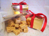 a picture of butter fusdge in a gold gift wrapped box