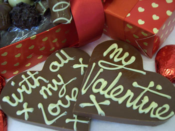 Two milk chocolate valentine decorated with White chocolate.  One display shows my 'Valentine message', the other, 'with all my love'