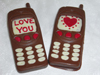 a picture of two valentine mobile phones