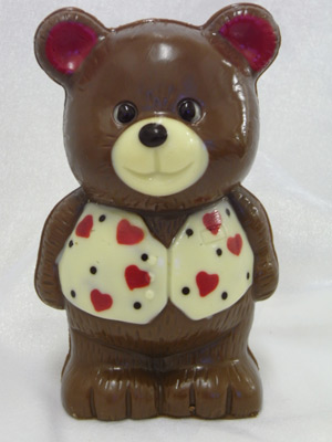 a picture of chocolate Valentine bear decorated with hearts