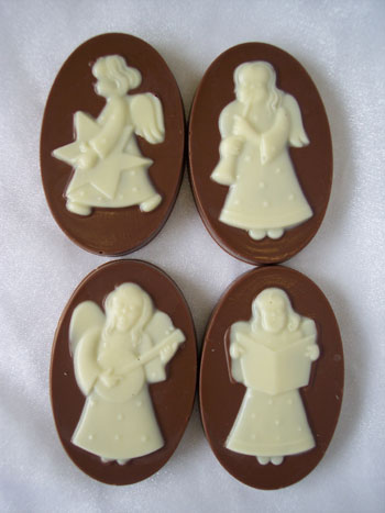 a picture of four white chocolate angels on milk chocolate bases.