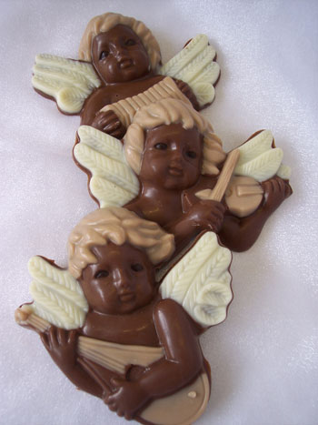 a picture of three milk chocolate cherubs, decorated with white and coloured chocolate.