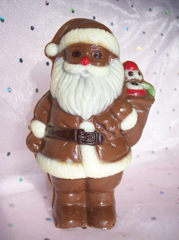 A milk chocolate Father Chirstmas decorated with white and coloured chocolate.