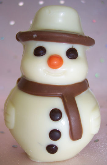 a picture of a small white chocolate snowman decorated with milk and dark chocolate.