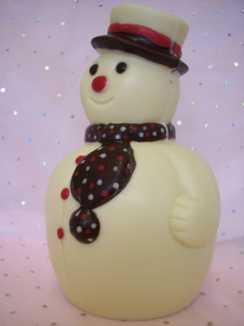 a picture of a white chocolate snowman decorated with coloured chocolate.
